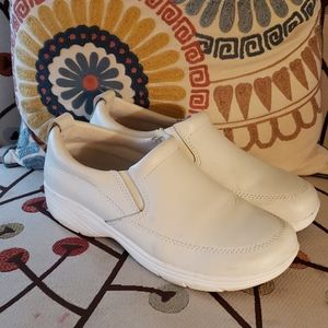 White leather clogs